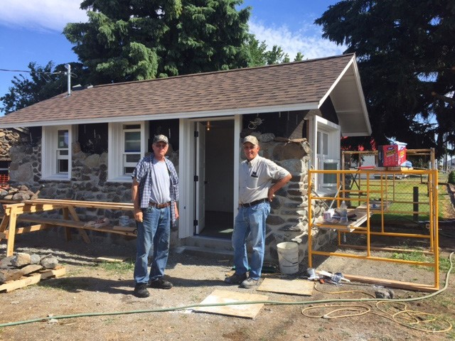 Volunteers Jeff Andrus and Jeff Johnson stop for a photo during the restoration of the Rock Bunkhouse in LaCrosse.