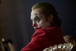"""This image released by Warner Bros. Pictures shows Joaquin Phoenix in a scene from """"Joker,"""" in theaters on Oct. 4. (Niko Tavernise/Warner Bros. Pictures via AP) - NIKO TAVERNISE/WARNER BROS. PICTURES VIA AP"""