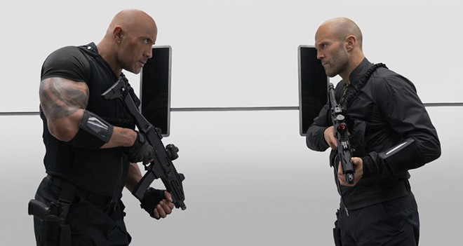 """This image released by Universal Pictures shows Dwayne Johnson, left, and Jason Statham in a scene from """"Fast & Furious Presents: Hobbs & Shaw."""" - AP"""