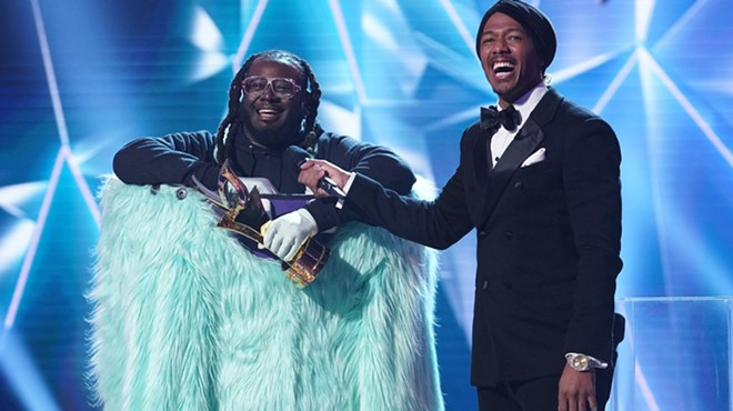 "T-Pain is revealed as the winner on Fox singing competition ""The Unmasked Singer."""