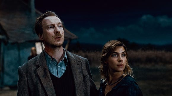 """David Thewlis as Remus Lupin and Natalia Tena as Nymphadora Tonks in """"Harry Potter and the Deathly Hallows: Part I."""" - PHOTO: © 2010 WARNER BROS. ENT. HARRY POTTER PUBLISHING RIGHTS © J.K.R."""