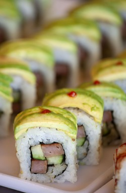 Spam roll is one of the varieties of sushi than Jonathan Rau sells at One World Cafe in Moscow.