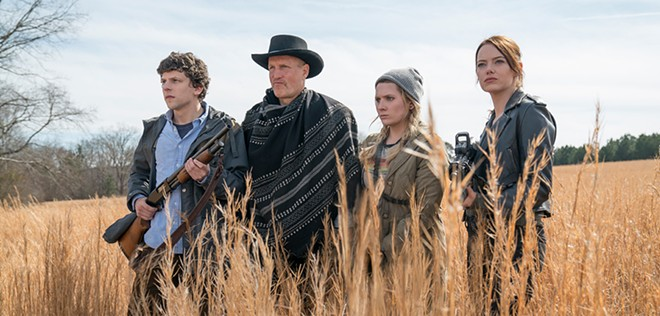 """From left: Jesse Eisenberg, Woody Harrelson, Abigail Breslin and Emma Stone appear in a scene from """"Zombieland: Double Tap"""" in this photo from IMDb."""