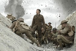 """This image released by Universal Pictures shows George MacKay, center, in a scene from """"1917,"""" directed by Sam Mendes. (François Duhamel/Universal Pictures via AP) - FRANÇOIS DUHAMEL/UNIVERSAL PICTURES VIA AP"""