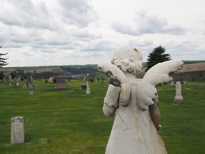 An angel statue on a child's grave overlooks the Colfax Cemetery. Tara Roberts/for Inland 360 - TARA ROBERT/INLAND 360