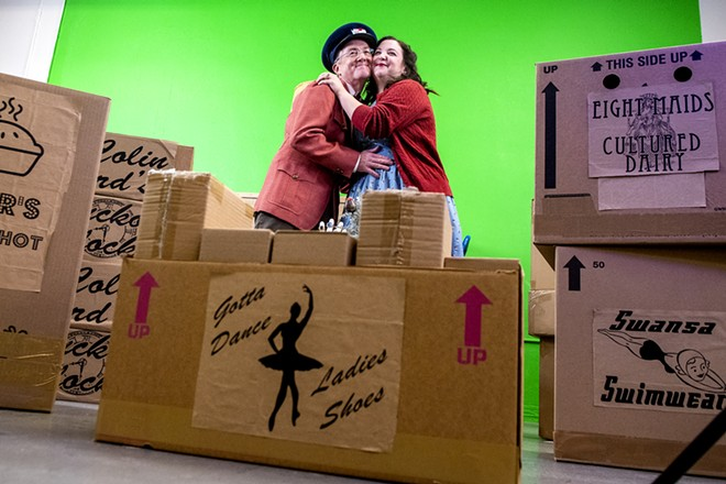 """Paul Segren and Gabi Segren embrace surrounded by gifts from """"The Twelve Days of Christmas"""" during a rehearsal of the Lewiston Civic Theater streamed play on Sunday, Nov. 15. - AUGUST FRANK/TRIBUNE"""