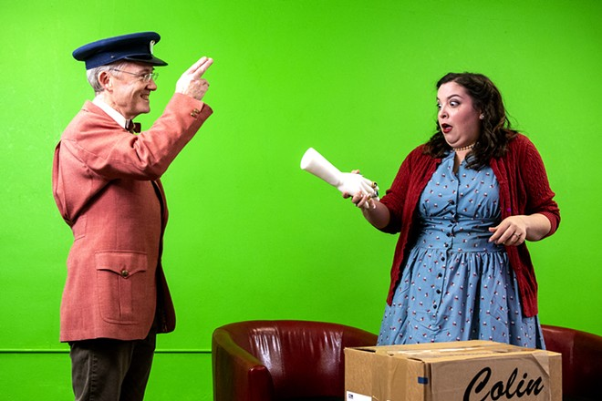 """Paul Segren tips his hat as Gabi Segren acts out in shock at pulling a fake hand with five golden rings out of a handshake during a rehearsal of """"The Twelve Days of Christmas"""" at the Lewiston Civic Theater offices on Sunday, Nov. 15., - AUGUST FRANK/TRIBUNE"""