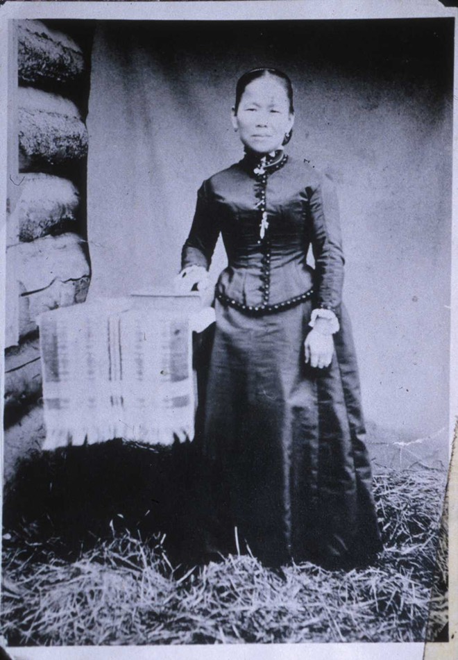 """Polly Bemis poses for a formal portrait in an image often called her """"wedding photo,"""" even though it was taken four months before the event. The 1894 photo is by John A. Hanson of Grangeville, who photographed Chinese people living in Warren in response to the Geary Act, which required Chinese immigrants to carry a certificate of residence."""