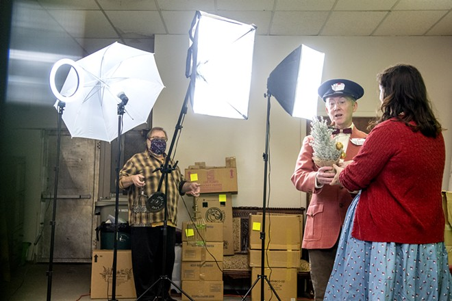 """Paul Segren presents Gabi Segren with a partridge in a pear tree as they practice their performance of """"The Twelve Days of Christmas"""" as director Patrick Broemeling stands by with two turtle doves at the Lewiston Civic Theater offices on Sunday, Nov. 15. - AUGUST FRANK/TRIBUNE"""