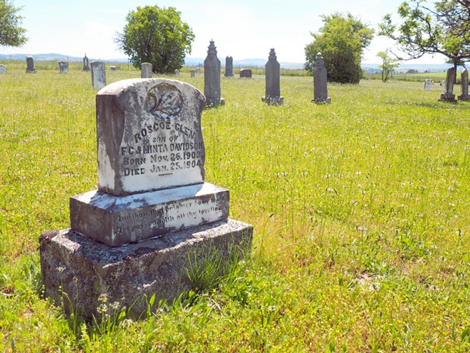 An infant's grave from the turn of the 20th century stands near the entrance to Wild Rose Cemetery outside Kendrick. Tara Roberts/for Inland 360 - TARA ROBERTS/INLAND 360