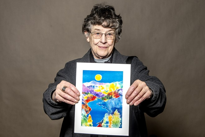 Bobbi Kelly holds up a piece of her art on Thursday. , - AUGUST FRANK/INLAND 360