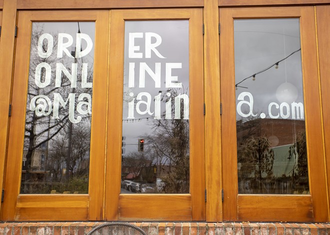 A sign in the window at Maialina reminds customers that they can order online on Thursday in Moscow. - AP