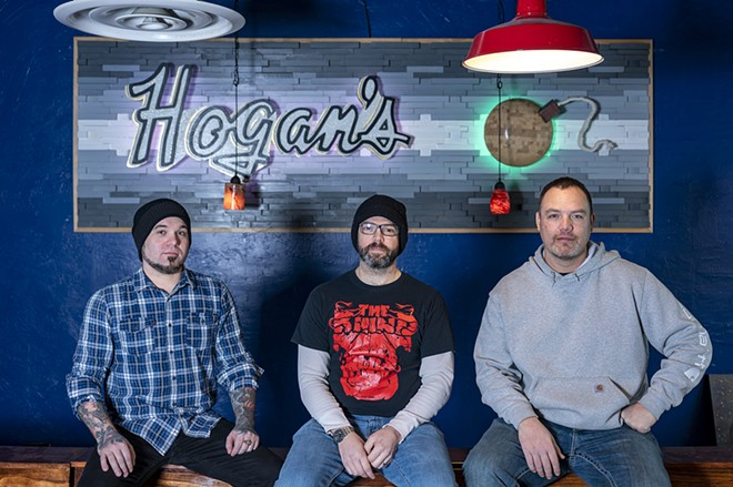Band members of the Maple Bars, Nathan Golla (left), Mason McCroskey (center) and Laki Ah-Hi, pose for a portrait inside Hogan's Pub in Clarkston. - PETE CASTER/TRIBUNE