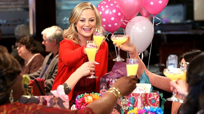 """Leslie Knope (Amy Poehler) celebrates Galentine's Day with her lady friends in an episode from the TV show """"Parks and Recreation."""" The holiday from the TV show is celebrated Feb. 13 and is gaining a mainstream following."""