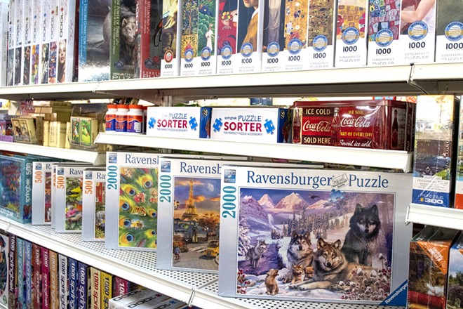 Puzzles are displayed on shelves at Hodgins Drug and Hobby in Moscow. According to owner Pam Hays, puzzles were very common items purchased during the COVID-19 pandemic. - ZACH WILKINSON/FOR INLAND 360