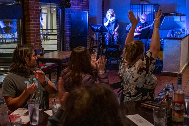 Sherry and Marty Lukenbill get an ovation after finishing a song during their second set on Friday, April 23, at Brock's in downtown Lewiston. - PETE CASTER/360