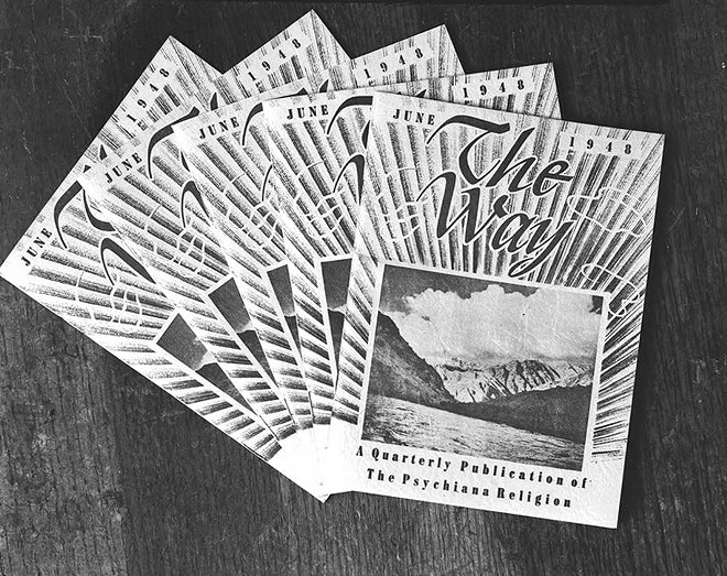 """Photograph of several copies of the June 1948 edition of the """"The Way: A Quarterly Publication of the Psychiana Religion."""" - PSYCHIANA DIGITAL COLLECTION, DIGITAL INITIATIVES, UNIVERSITY OF IDAHO LIBRARY"""