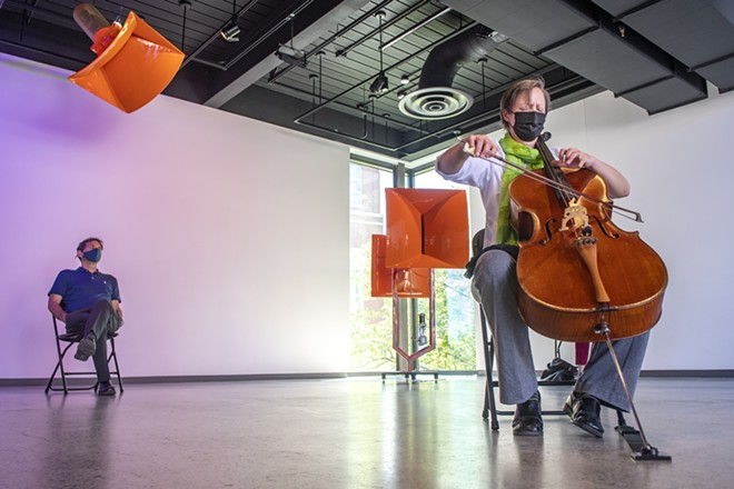 """Ruth Boden, the Coordinator of the Chamber of Music Program, - performs for an audience in the Jordan Schnitzer Museum - of Art pavilion at Washington State University. """"I feel more - relaxed now than I have in the last two years,"""" Boden said. - ZACH WILKINSON/INLAND 360"""