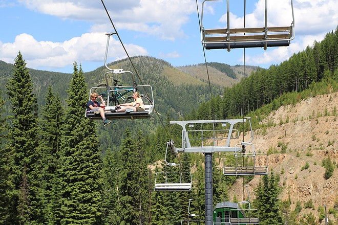 Lookout Pass ski lift with bike riders on it