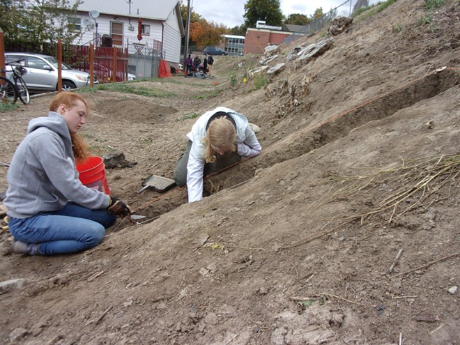 University of Idaho students Moira Riggs and Josee Grant excavate a trench at Moscow High School as part of an Idaho Public Archaeology community-based dig. - MARK WARNER