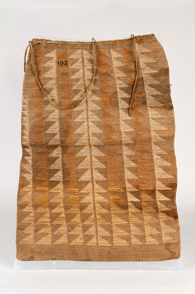 Large bag made from hemp and bear grass dyed with Oregon grape by a female member of the Nez Perce Tribe circa 1835. Lynne Pinham retrieved the bag from Ohio after the bulk of the collection had been returned. - NEZ PERCE NATIONAL HISTORICAL PARK, SPALDING