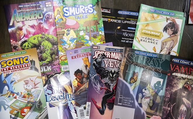 A collection of comic books that will be given away as part of Free Comic Book Day are displayed on a table while being sorted at Safari Pearl in Moscow. - ZACH WILKINSON/INLAND 360