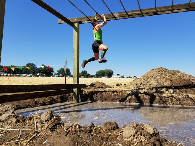 A person navigates one of the obstacles in the last LC Valley Down and Dirty Mud Run in 2017. The run returns Saturday in a new location in Lewiston. - LC VALLEY MUD RUN