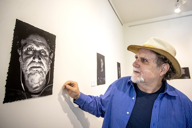Sean Cassidy takes in his self-portrait at the Lewis-Clark State Center for Arts & History exhibit as part of the Beautiful Downtown Lewiston's annual Artwalk. - AUGUST FRANK/360