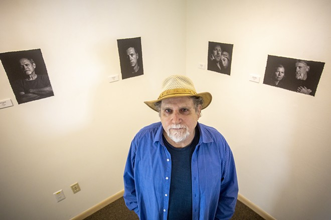 Sean Cassidy stands in front of his photographs at the Lewis-Clark State Center for Arts & History exhibit as part of the Beautiful Downtown Lewiston's annual Artwalk. - AUGUST FRANK/360