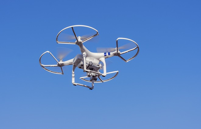 A drone flies in the sky in this file photo. - DREAMSTIME/TNS