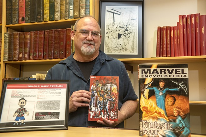 Surrounded by Marvel memorabilia, Mark O'English, an archivist at Washington State University, poses for a portrait inside the Terrell Library on Wednesday afternoon, Sept. 22, 2021. O'English previously worked for Marvel on the Fantastic Four completing encyclopedias. - ZACH WILKINSON/INLAND 360