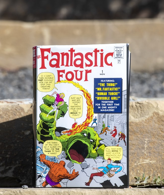 A Fantastic Four volume one omnibus sits on a set of steps at the University of Idaho Arboretum and Botanical Garden on Friday afternoon, Oct. 1, 2021. - ZACH WILKINSON/INLAND 360