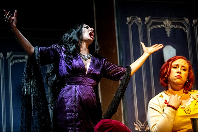 Amy Stout, playing Morticia Addams, sings to Amanda Marzo, playing Alice Beineke, about honesty and marriage during a rehearsal for the Addams Family at the old Lewiston High School on Monday evening. - AUGUST FRANK/360