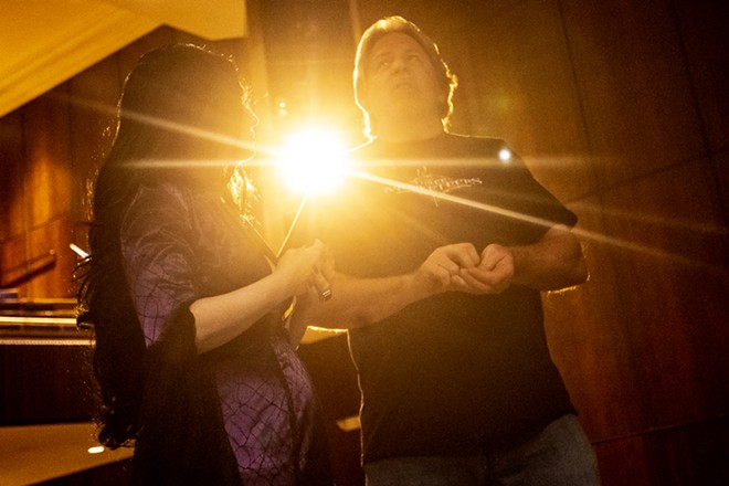 Amy Stout, playing Morticia Addams, talks with Director Larry Goodwin between scenes during a rehearsal for the Addams Family at the old Lewiston High School on Monday evening. - AUGUST FRANK/360