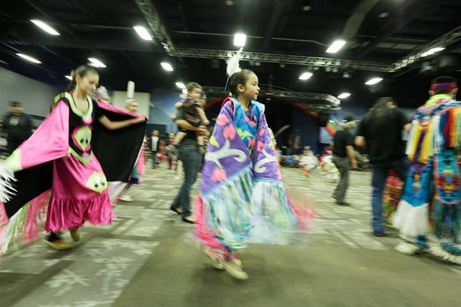 10-year-old Arlee Nicholson, center, and 11 year old Cierra Antoine, left, both of The Confederated Tribes of the Colville Reservation, dance. - YOUNG KWAK