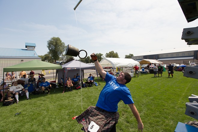 Kobie Hamm, 17, from Sandy, Ore., attempts a weight over a bar during the men's amateur A & B competition. - YOUNG KWAK