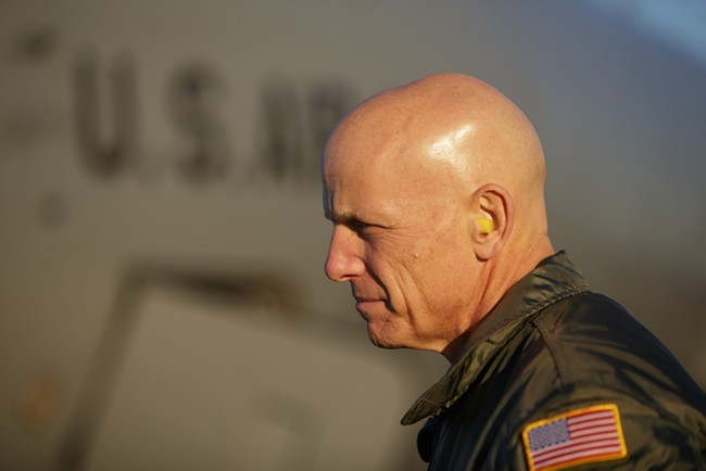 376th Air Expeditionary Wing Command Chief Master Sergeant Gregory Warren stands in front of a KC-135. - YOUNG KWAK