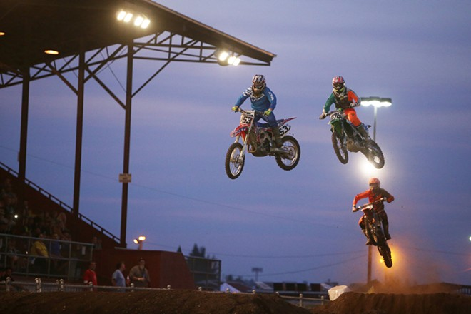 45c cc pro riders Greg Crater (153), from Renton, Wash., Collin Jurin (476), from Monroe, Wash., and Jake Anstett (474) from Port Angeles, Wash., take a jump in a Moto 1 race. - YOUNG KWAK
