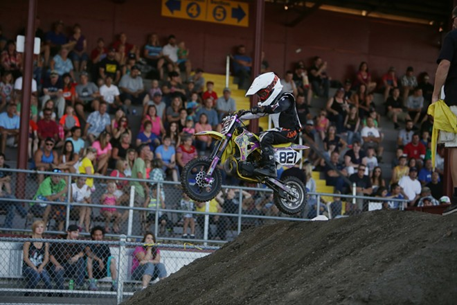 7 year old 50 cc amateur rider Wyatt Storey (821), from Cataldo, Idaho takes a jump in a Moto 1 race. - YOUNG KWAK
