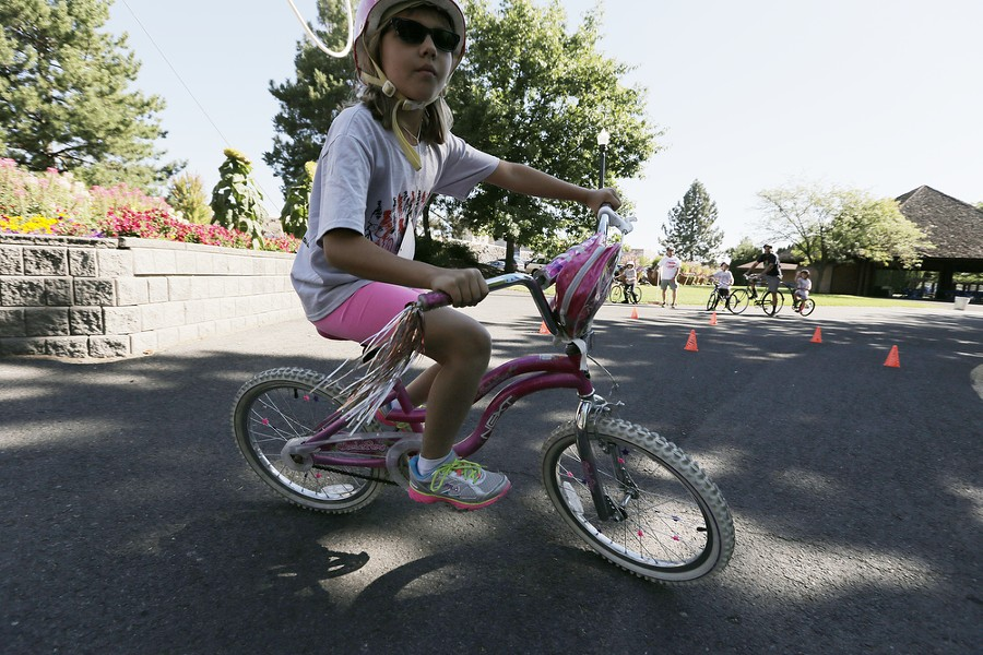 9 year old brooke Hammond rides a slalom course during the Park Loop and Bike Safety Rodeo route. - YOUNG KWAK