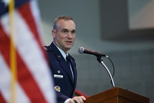 92nd ARW Commander U.S. Air Force Col. Brian Newberry speaks during a Veterans Day Ceremony. - YOUNG KWAK