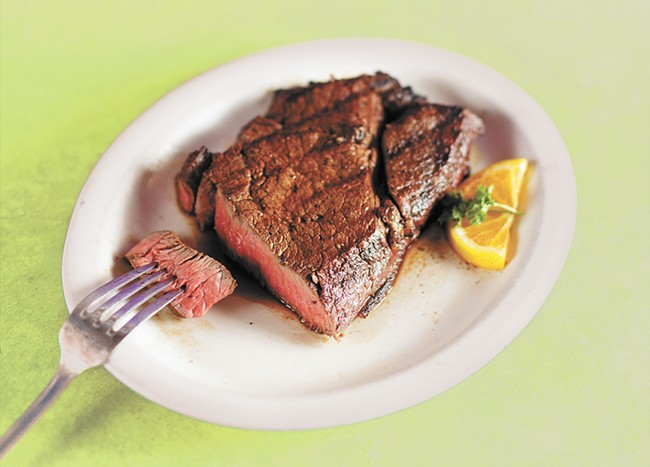 A 26 oz. cowgirl top sirloin steak from the Wolf Lodge Steakhouse located just outside of Coeur d'Alene. - YOUNG KWAK