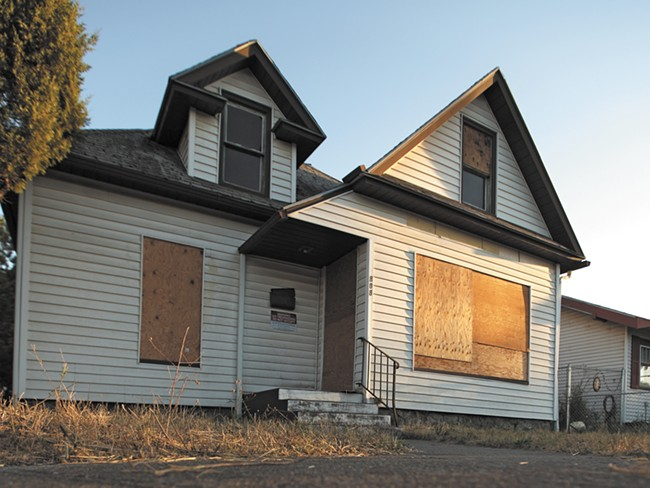 A boarded-up home owned by the city of Spokane.