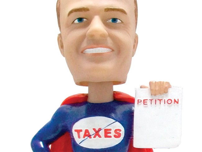 A bobble-headed doll of initiative crusader Tim Eyman
