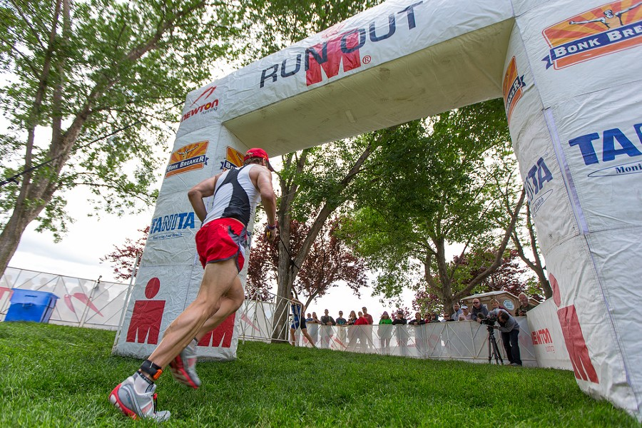 A competitor exits the transition area to begin the 26.2-mile run at the Coeur d'Alene Ironman. - MATT WEIGAND