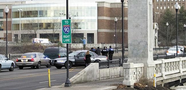 A distraught man stands on the Monroe Street Bridge on Dec. 18. - JACOB JONES