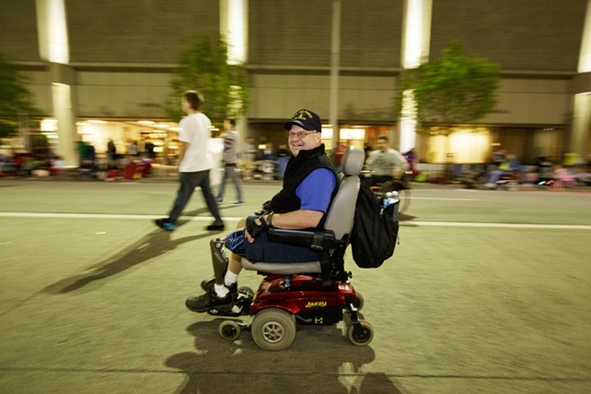A member of the Inland Northwest Disabled Veterans Sports Association passes by. - YOUNG KWAK