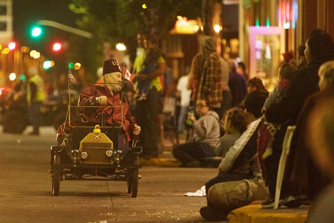 A member of the Northeast Washington Shrine Club drives by in one the organization's tiny cars. - YOUNG KWAK
