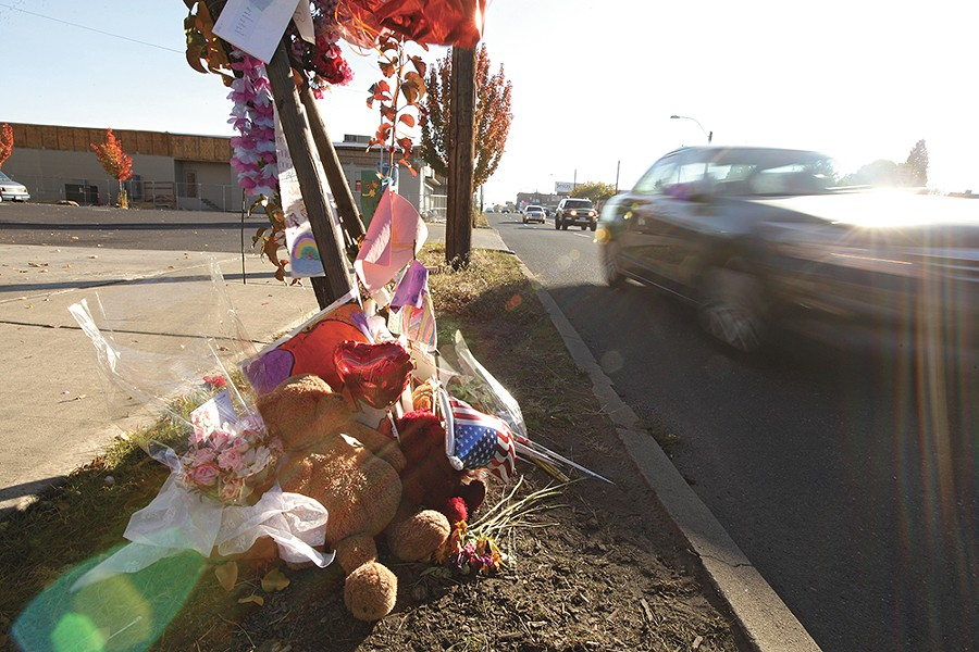 A memorial dedicated to Elayna Burrows-Gust grows along a stretch of North Monroe Street. - YOUNG KWAK