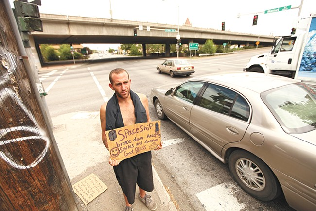 A panhandler in downtown Spokane in summer 2012. - YOUNG KWAK